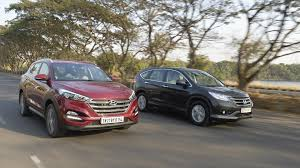 hyundai tucson or honda crv honda cr v vs hyundai tucson comparison taking the with the
