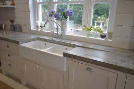 double belfast sink with concrete tops and in built drainer