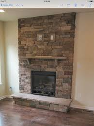 stacked stone fireplace with tv mount new house final selections