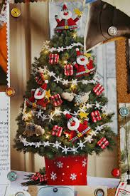 xmas tree decorating ideas with unique green orange brown and gold
