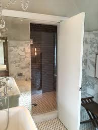 water closet with mirrored door transitional bathroom