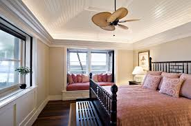 dark wood ceiling fan dark wood ceiling fan bedroom tropical with pink duvet foot of the
