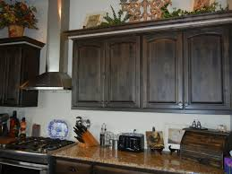 pictures of black stained kitchen cabinets distressed black walnut stain with island american