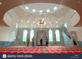 muslims are pictured at the prayer room of the new mosque in