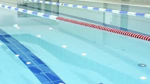 In Door Pool Blue Water Surface And Red Lane Marker At Indoor Swimming