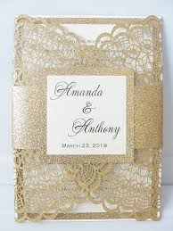 wedding invitations and gold doily gold glitter
