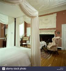 Four Poster Bed Curtains Drapes Four Poster Bed With White Drapes And Linen In Terracotta Bedroom