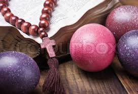 wooden easter eggs that open decorated with painted easter eggs and an open bible wooden table