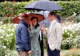 william kate and harry visit kensington palace garden on rainy
