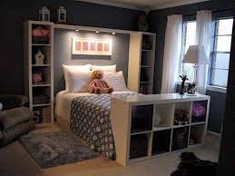 comfortable bedroom in dark colors and shelves in the interior