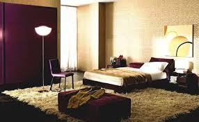 black fabric single seater sofa dark purple bedroom wooden wall
