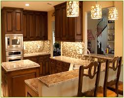 brown kitchen cabinets with new venetian gold granite countertop