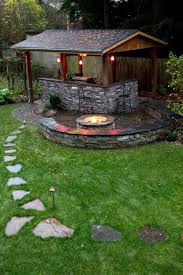 Backyard Brick Patio Design With Grill Station Seating Wall And by Awesome Brick U0026 Stone Patio Make Incredible Use Of A Small