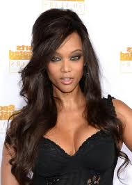black people short hair cut with part down the middle tyra banks 1960s retro half up half down hairstyle for black women