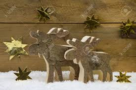 Wooden Deer Christmas Decorations by Two Wooden Handmade Reindeer For Christmas Decoration With Natural