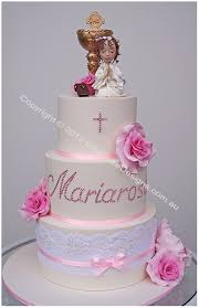 first holy communion cake with a praying by