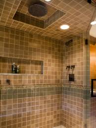 this large shower features tile in warm neutral tones with an