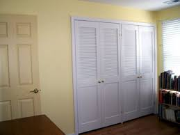White Closet Doors Bedroom Bedroom With Wooden Bed Frame And White Louvered Closet Doors