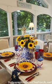 a sunflower centerpiece for a 4th july table setting