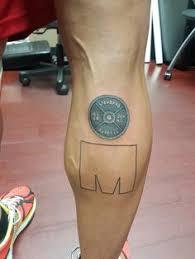 ironman triathlon tattoo at holy roller tattoo holy roller