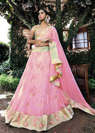 pink embroidered wedding dress and gold floral embroidered lehenga