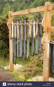slate wind chimes at the eden project cornwall stock photo