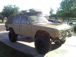 tan jeep cherokee from tactical to utterly im practical jeep cherokee hummer