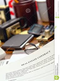 real estate contract document on realtor desk royalty free stock