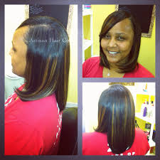 full sew in w leave out and custom highlights artisan hair