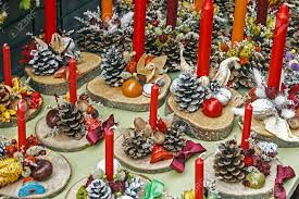 christmas decorations with pine cones wood candles and various