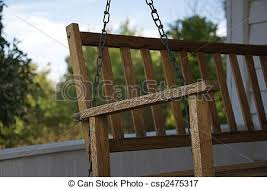 front porch swing a wooden swing hangs on an old style picture