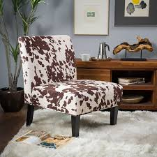 furniture cozy family room with cowhide chairs and white wool