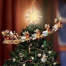 lighted tree topper the kinkade revolving christmas tree topper hammacher