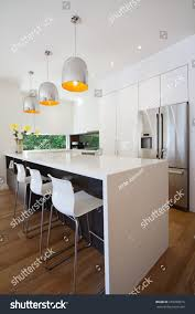 modern australian kitchen renovation waterfall stone stock photo
