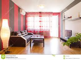 room with black wall and red sofa happy new year stock living room with black and red striped walls royalty free stock photo