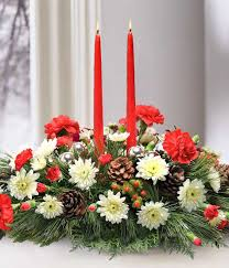 colorful christmas wedding centerpiece with bouquet of red roses