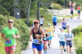 harbor lights half marathon runners see light house during blueberry cove half marathon by