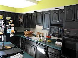 black painted kitchen cabinets with black appliances outdoor