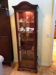 curio cabinet with light glass display case w curved front halogen lights mirrored back