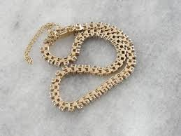 classic diamond bracelet images Classic diamond tennis bracelet with safety chain in yellow gold jpg