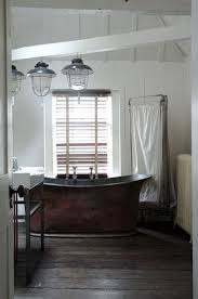 149 best powder room latrine washroom bathrooms privy images gorgeous vintage copper bath with industrial fisherman s lights alastair hendy s restored georgian home and shop from the telegraph love this tub