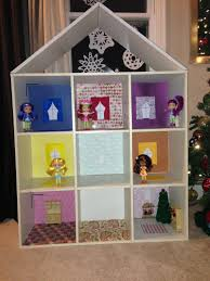 home made doll house out of a cube bookshelf roof was added and
