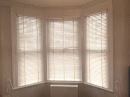 wooden venetian blinds fitted to a bay window in welling kent