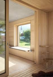 blackened timber house by bernardo bader architekten stands on the