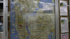 Nyc Subway Map High Resolution by Subway Map At Times Square Station Reflection Of Moving Train Nyc