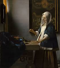 vermeer pearl necklace woman holding a balance