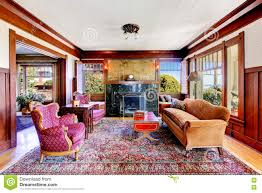 living room with wooden panel trim walls and vintage furniture