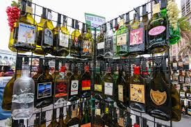 rack with empty flat souvenir popular alcohol drinks bottles