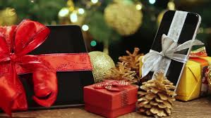 tablet pc smartphone and smartwatch with gifts and decorations in