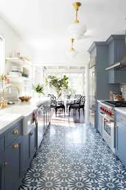 best ideas about blue cabinets pinterest navy galley style kitchen with patterned floor and blue cabinets